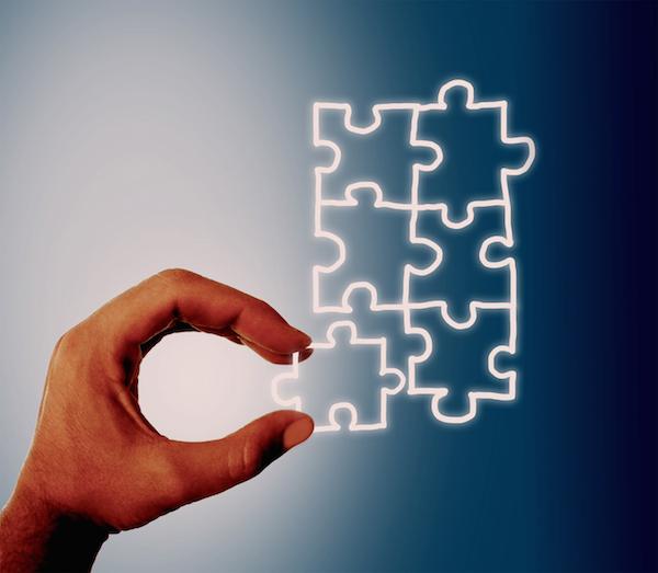 Hand assembling jigsaw on virtual screen